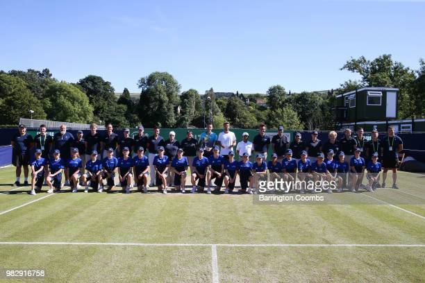Sergiy Stakhovsky of the Ukraine and Oscar Otte of Germany pose with the ground staff and ball boys after the Men's final between Sergiy Stakhovsky...
