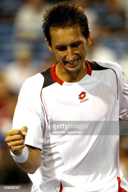 Sergiy Stakhovsky of the Ukraine celebrates a point over Denis Istomin of Uzebekistan during the final of the Pilot Pen tennis tournament at the...