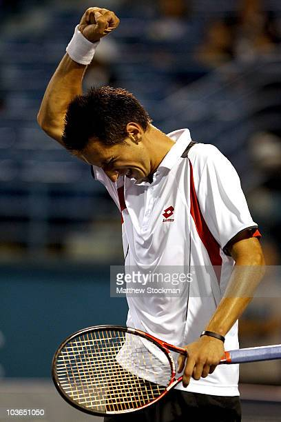 Sergiy Stakhovsky of the Ukraine celebrates match point against Marcos Baghdatis of Cyprus during the Pilot Pen tennis tournament at the Connecticut...