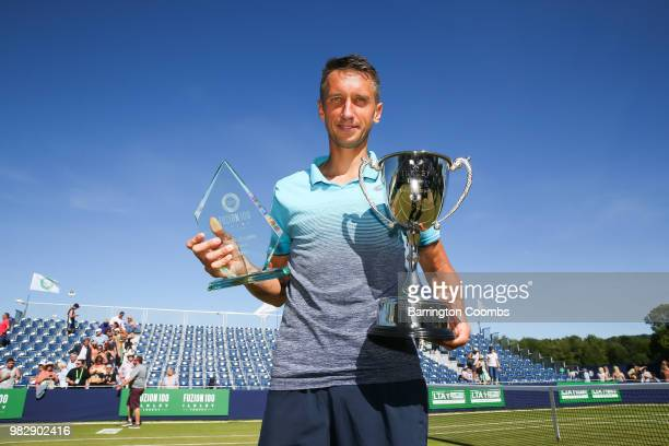 Sergiy Stakhovsky of the Ukraine poses with his trophies after winning the final against Oscar Otte of Germany on day Eight of the Fuzion 100 Ikley...