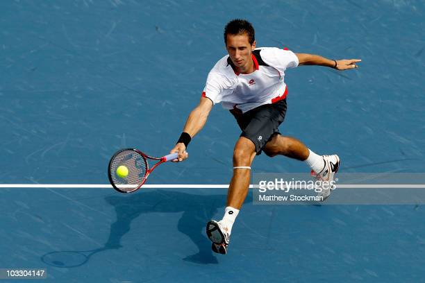Sergiy Stakhovsky of the Ukraine returns a shot to Richard Gasquet of France during the Rogers Cup at the Rexall Centre on August 9, 2010 in Toronto,...
