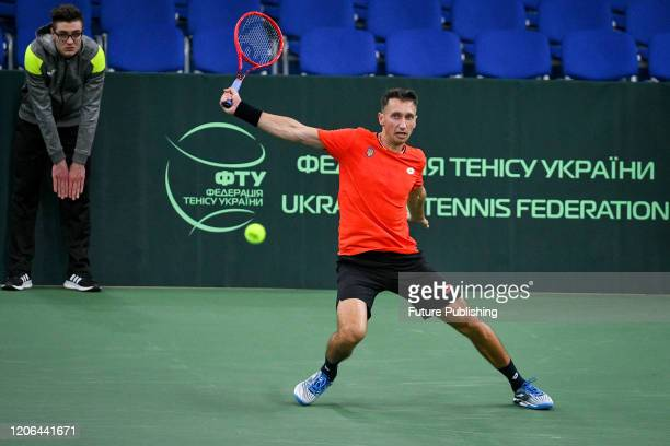 Sergiy Stakhovsky of Ukraine eyes the ball during a match with Tung-Lin Wu of Chinese Taipei during the Davis Cup World Group I First Round Play-Offs...