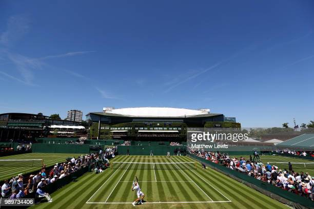 Sergiy Stakhovsky of Ukraine plays against Joao Sousa of Portugal during their Men's Singles first round match on day one of the Wimbledon Lawn...