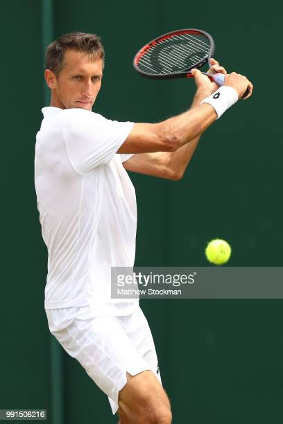 Sergiy Stakhovsky of Ukraine returns against Sam Querry of The United States during their Men's Singles second round match on day three of the...