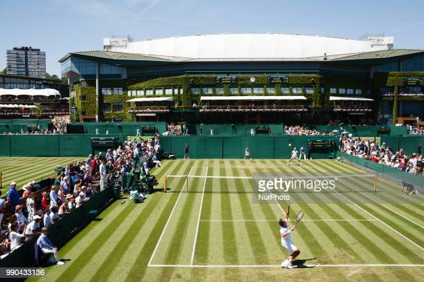 Sergiy Stakhovsky of Ukraine serves against Joao Sousa of Portugal in the first round of the 2018 Wimbledon Championships at the All England Club in...