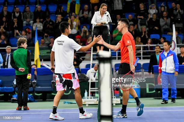 Sergiy Stakhovsky of Ukraine shakes hands with Tung-Lin Wu of Chinese Taipei during their match during the Davis Cup World Group I First Round...