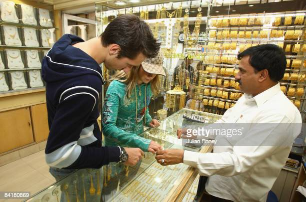 Sergiy Stakhovsky of Ukraine with his girlfriend shop for jewelry in the gold souk district of Doha during the Exxon Mobil Qatar Open Tennis on...