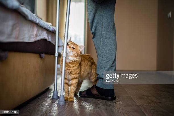 Sergiy Tarasiuk ATO veteran stands at his apartment in Irpin Kyiv region Ukraine Sergiy Tarasiuk lost his left leg in 2014 after 3 months of the...