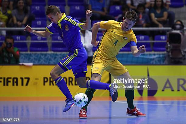 Sergiy Zhurba of Ukraine and Greg Giovenali of Australia vie for the ball during Group D match play between Australia and Ukraine in the 2016 FIFA...