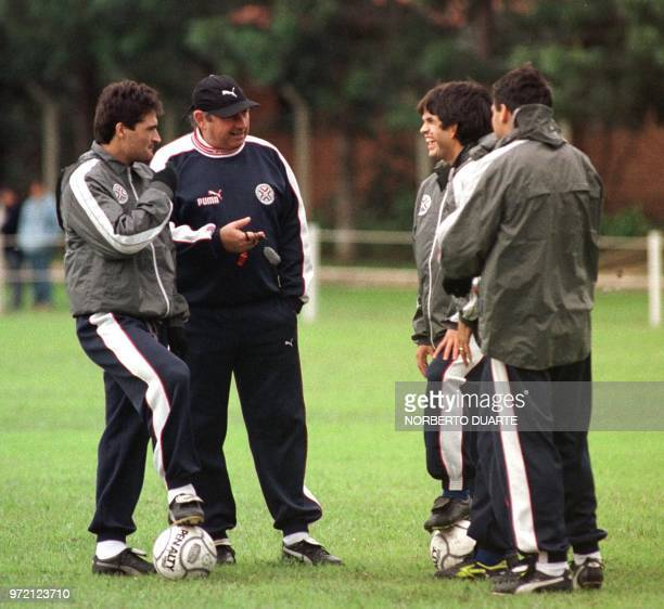 Serguio Markarian technical director for Paraguay's select soccer team talks with players Roberto Acuna Diego Gavilan Jose Cardozo and Celso Ayala as...