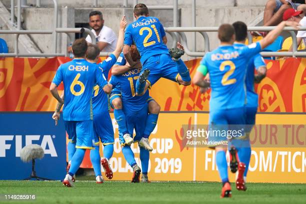 Serhii Buletsa of Ukraine U20 celebrates with teammates after scoring the opening goal during the 2019 FIFA U20 World Cup Semi Final match between...