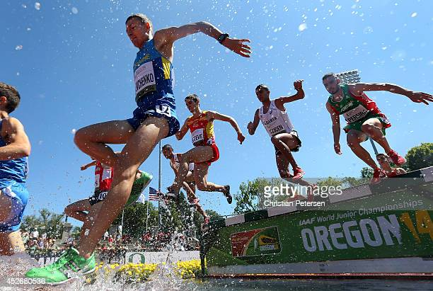 Serhii Shevchenko of Ukraine leads runners over the water pit as they compete in the men's steeplechase heats during day four of the IAAF World...