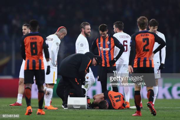 Serhiy Kryvtsov of Shakhtar Donetsk receives medical treatment during the UEFA Champions League Round of 16 First Leg match between Shakhtar Donetsk...