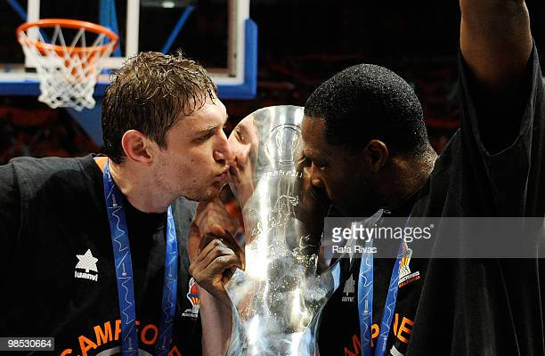 Serhiy Lishchuk #12 and Florent Pietrus kiss the Eurocup trophy during the Champion Award Ceremony at Fernando Buesa Arena on April 18 2010 in...