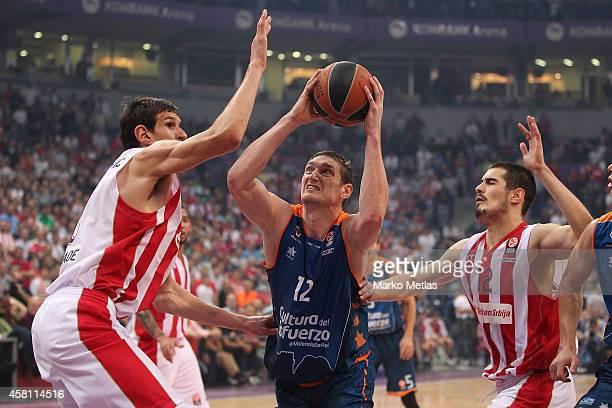 Serhiy Lishchuk, #12 of Valencia Basket competes with Boban Marjanovic, #13 of Crvena Zvezda Telekom Belgrade during the 2014-2015 Turkish Airlines...