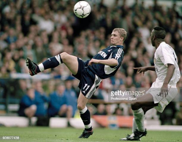 Serhiy Rebrov of Tottenham Hotspur volleys the ball ahead of Lucas Radebe of Leeds United during an FA Carling Premiership match at Elland Road on...