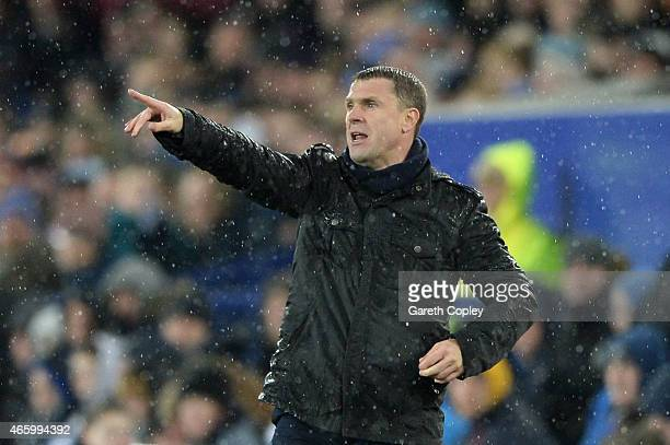 Serhiy Rebrov the manager of Dynamo Kyiv directs his players during the UEFA Europa League Round of 16 first leg match between Everton and FC Dynamo...