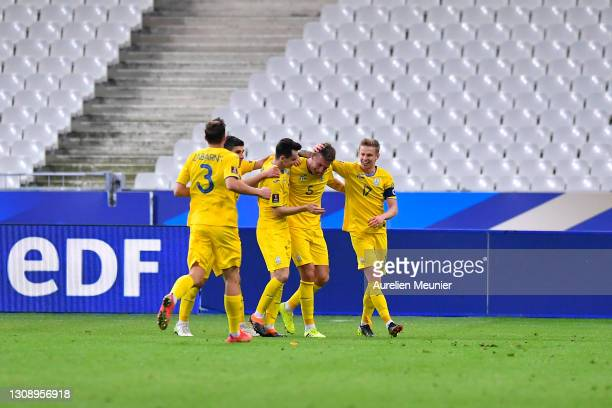 Serhiy Sydorchuk of Ukraine celebrates with Oleksandr Zinchenko and team mates after scoring their side's first goal during the FIFA World Cup 2022...