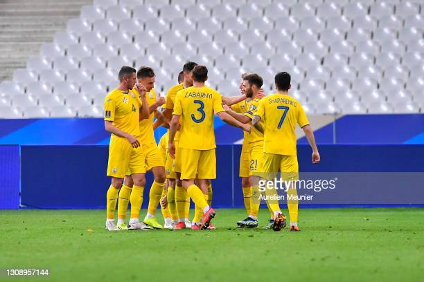 Serhiy Sydorchuk of Ukraine celebrates with team mates after scoring their side's first goal during the FIFA World Cup 2022 Qatar qualifying match...