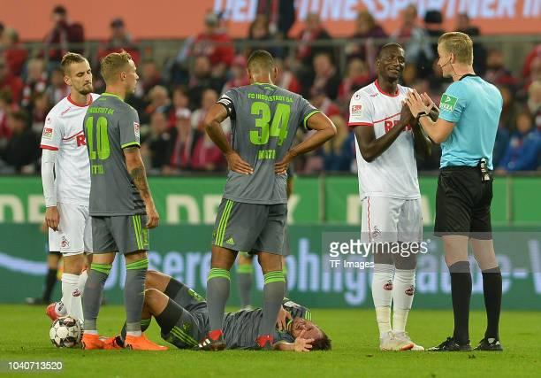 Serhou Guirassy of FC Koeln speaks with Referee Arne Aarnink during the Second Bundesliga match between 1 FC Koeln and FC Ingolstadt 04 at...
