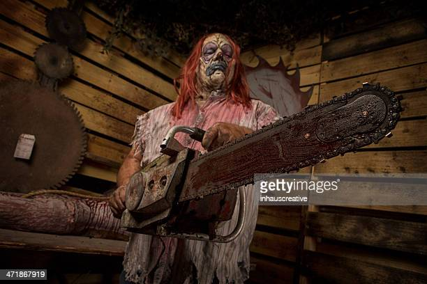 Serial Killer Clown holding chain saw