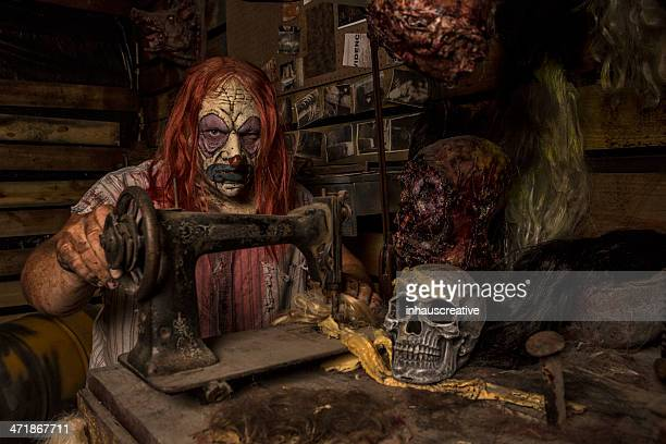 serial killer clown sewing in his cabin - sad clown stock photos and pictures