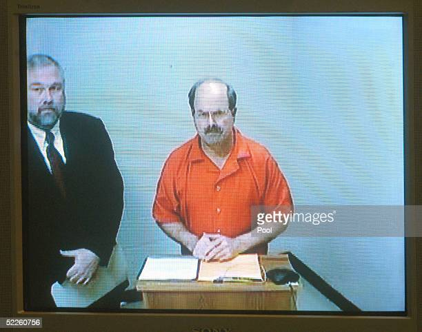 Serial murder suspect Dennis Rader appears on a video screen as he makes his first court appearance via video feed from the Sedgwick County Jail...