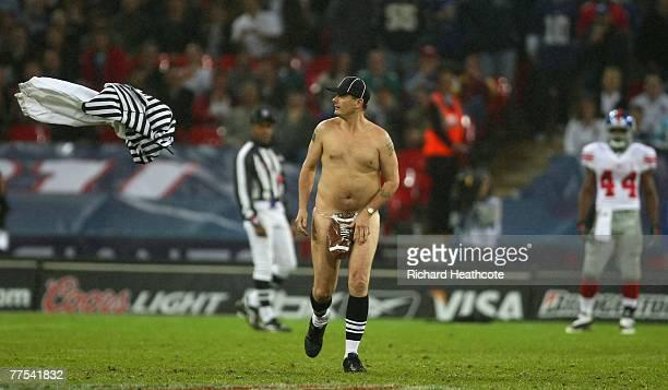 'Serial streaker' Mark Roberts runs onto the field of play during the NFL Bridgestone International Series match between New York Giants and Miami...