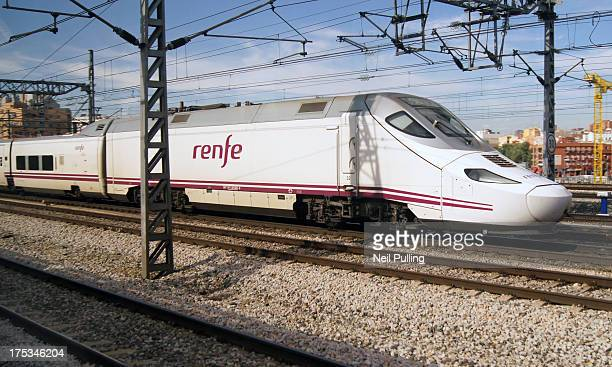 CONTENT] TALGO 250 / Serie 130 de Renfe high speed train seen on approaches to Madrid Atocha station