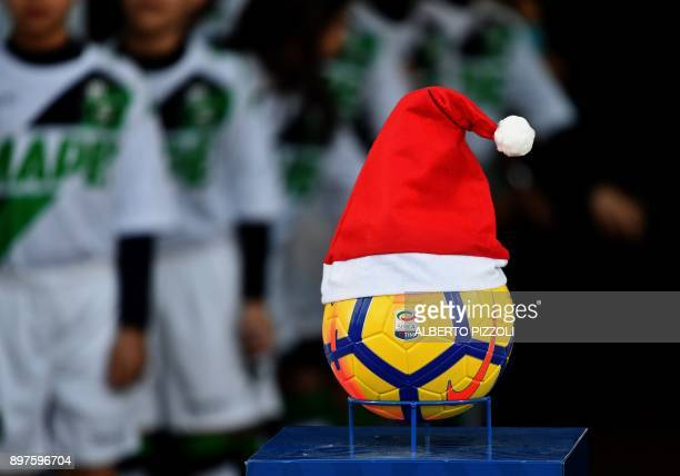 Serie A football with a Santa Claus hat placed on it is diplayed before the Italian Serie A football match Sassuolo vs Inter Milan on December 23...
