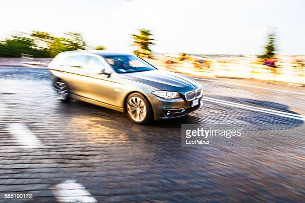 BMW 5 Serie SW at dusk in Rome Italy