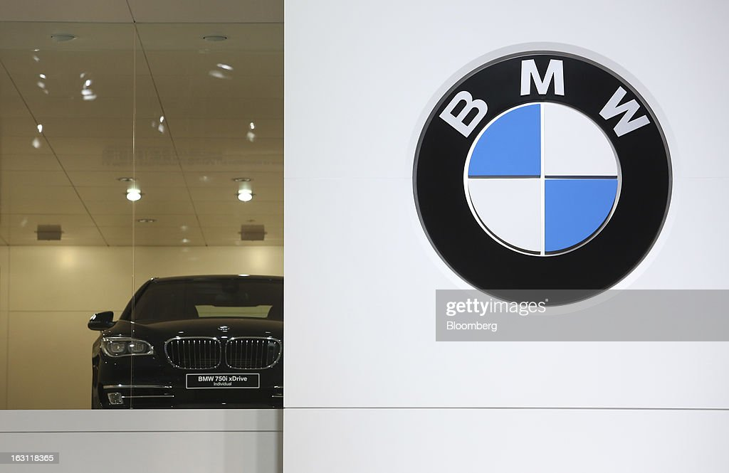 A BMW 7 series automobile, produced by Bayerische Motoren Werke AG (BMW), is displayed on the company's stand ahead of the opening day of the 83rd Geneva International Motor Show in Geneva, Switzerland, on Monday, March 4, 2013. This year's show opens to the public on Mar. 7, and is set to feature more than 100 product premiers from the world's automobile manufacturers. Photographer: Chris Ratcliffe/Bloomberg via Getty Images