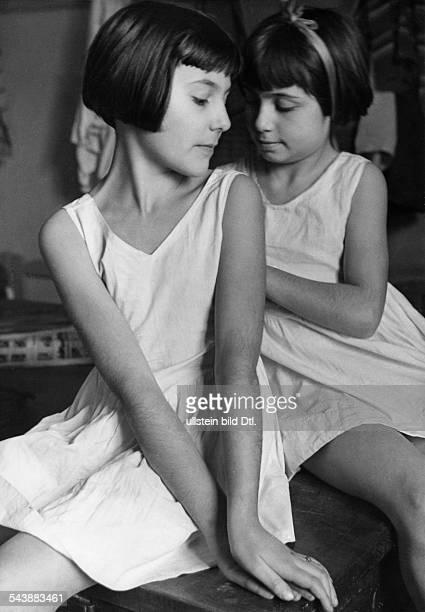 Series: Children ballet school of Milanese Scala - two girls before the ballet training - Photographer: Alfred Eisenstaedt- 1934Vintage property of...