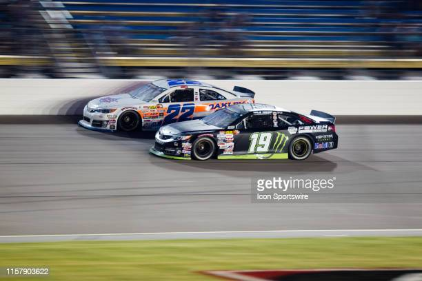 Series driver Brandon Oakley and NASCAR KN Series driver Hailie Deegan race side by side during the NASCAR KN Pro Series Casey's General Store 150 on...