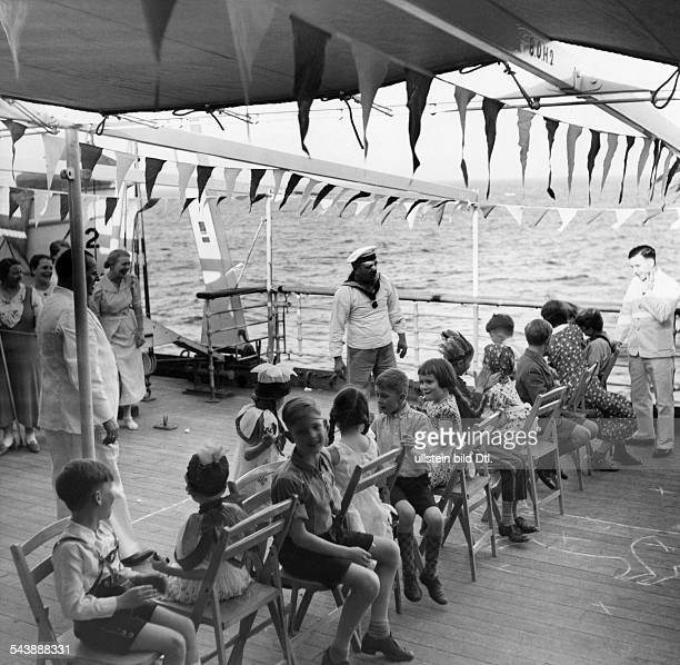 Series 'Going to Kapstadt with children' children at a children's party playing musical chairs 1937 Photographer Steinhoff Published by 'Die Dame'...