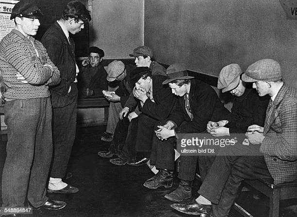Series hostel for juvenile homeless in Berlin Charlottenburg teenagers waiting before the opening at waiting room Photographer Felix H Man Dephot...