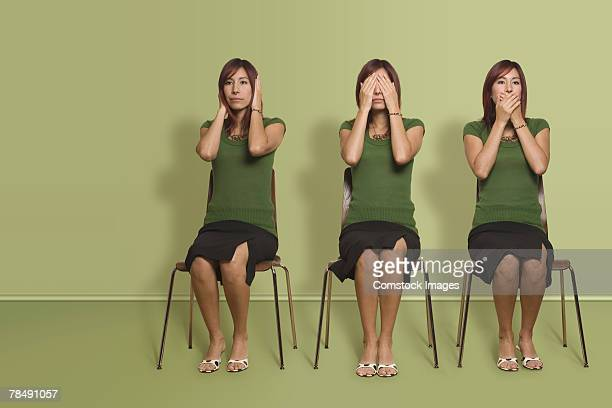 Series of a woman with hear no evil, see no evil and speak no evil