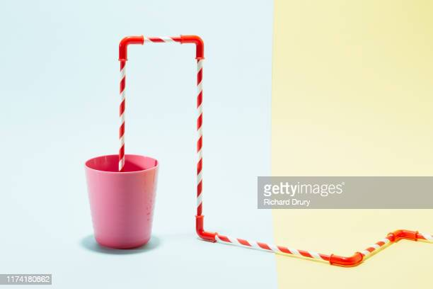 a series of connected drinking straws in a cup - joining the dots stock pictures, royalty-free photos & images