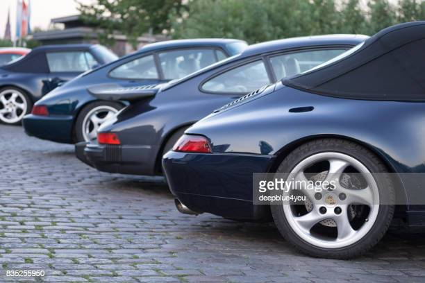 A series of different porsche 911 vehicles parked during the Magnus Walker event on the Hamburg Fischmarkt