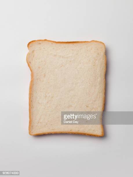 series of different sliced white bread slices, some with butter, crust and pile of slices against a white background shot from above - bread stock pictures, royalty-free photos & images