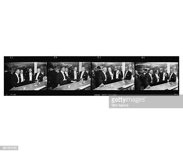 Series of four shots of film stars Clark Gable , Van Heflin , Gary Cooper and James Stewart enjoying a joke at a New Year's party held at Romanoff's...