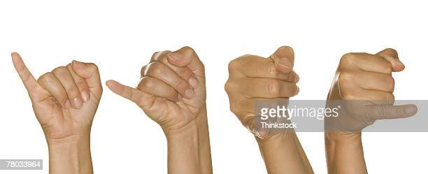 Series of hands making J sign