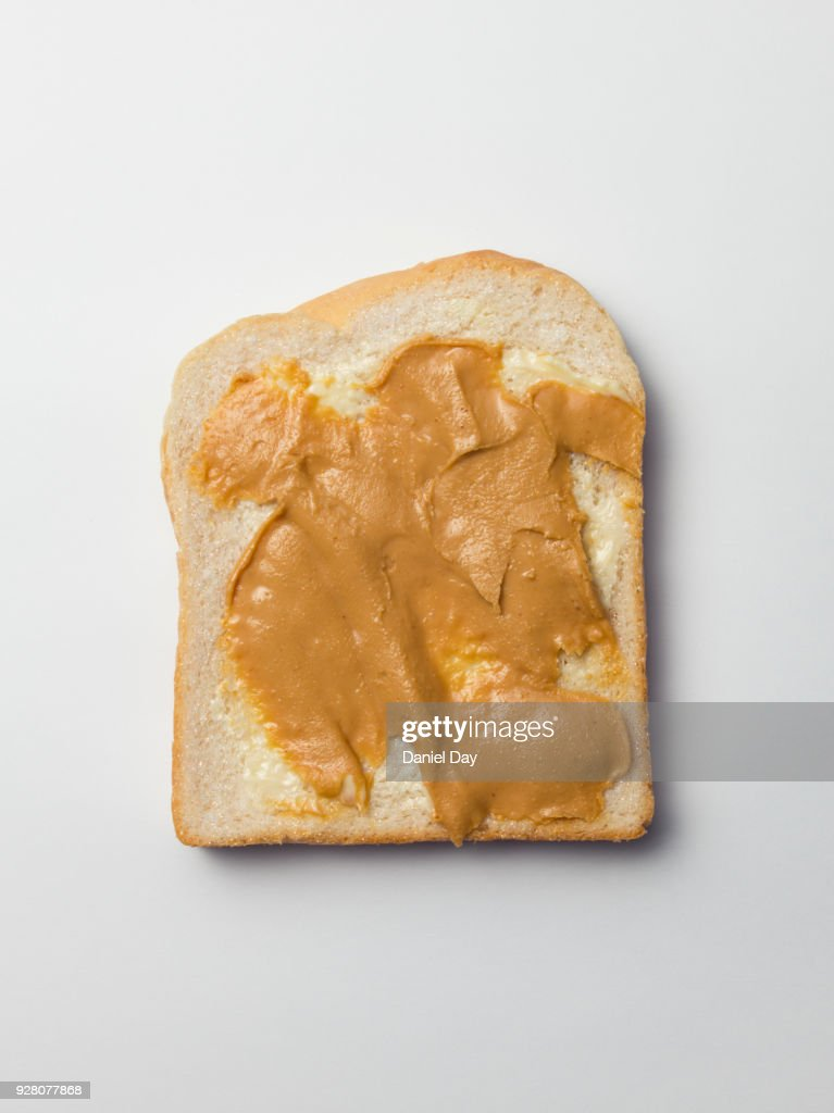 A series of images of slices of white bread covered with diamanté and glitter on peanut butter : Stock Photo