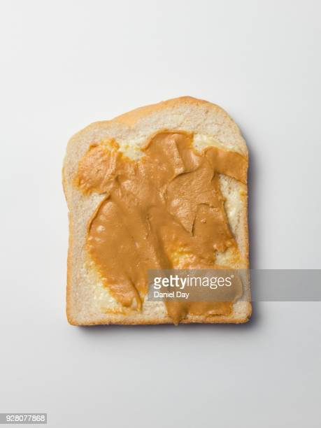 A series of images of slices of white bread covered with diamanté and glitter on peanut butter