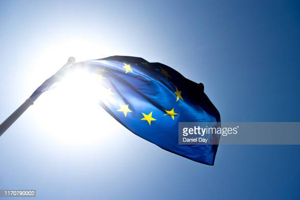 series of images of the eu flag flying in the wind, backlight and blue sky - entertainment occupation stock pictures, royalty-free photos & images