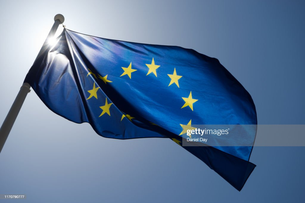 Series of images of the EU flag flying in the wind, backlight and blue sky : Stock Photo