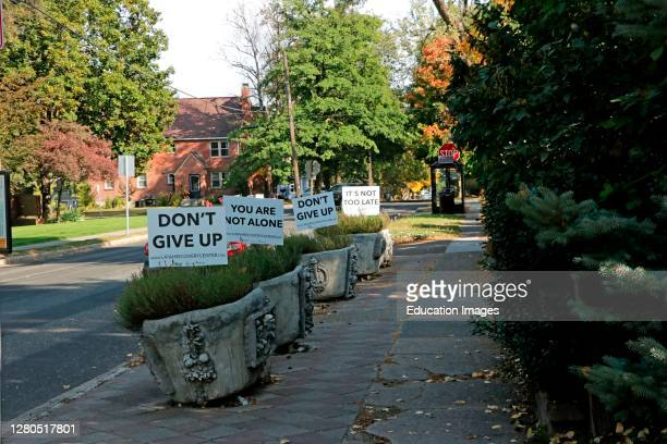 Series of lined up signs focused on mental health assistance during the Covid pandemic crisis.