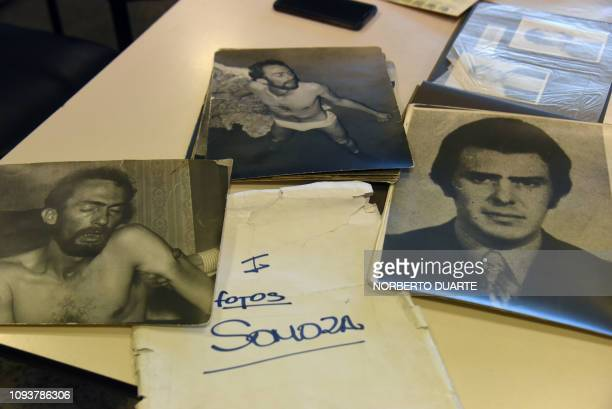 A series of pictures that form part of the 'Archives of Terror' are seen at the Documentation and Archive Center for Human Rights Defense at the...