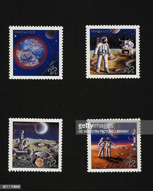 Series of postage stamps commemorating Space conquests depicting top from left Mars American astronaut on the moon bottom from left Soviet spacecraft...
