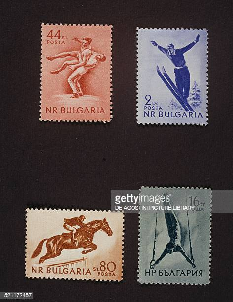 Series of postage stamps honouring Sports depicting top Wrestling Ski Jumping bottom Horse riding and Gymnastics rings Bulgaria 20th century Bulgaria